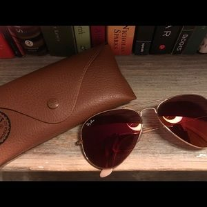 Red tinted ray bans, never worn. With case